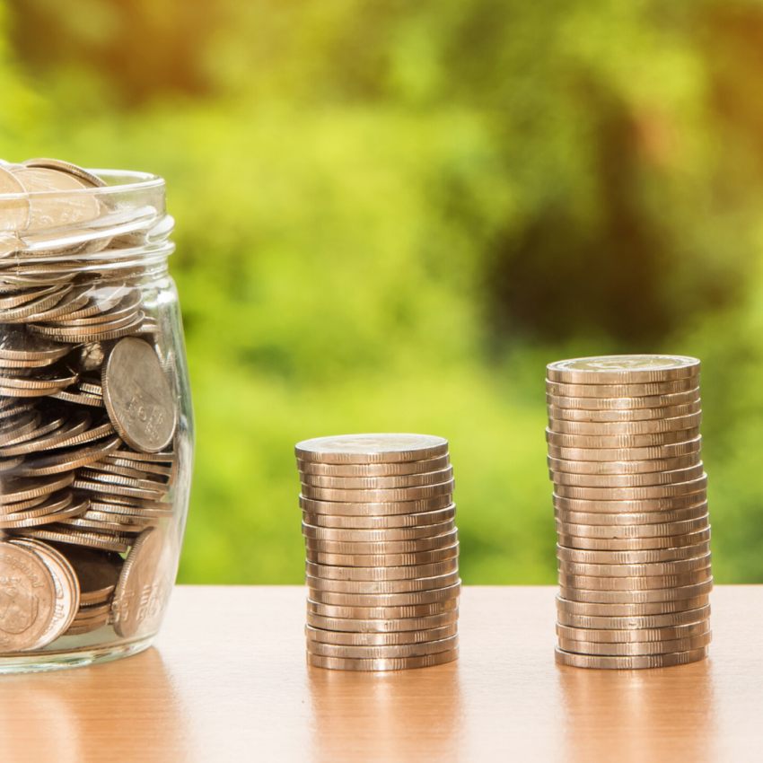 Money In Jar and Stacked Personal Loans or Payday Loans